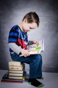 Child Reading Books Agape House of Prescott