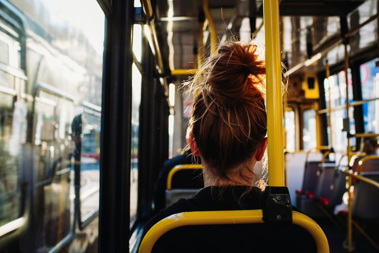 Female sitting in the bus captured from behind